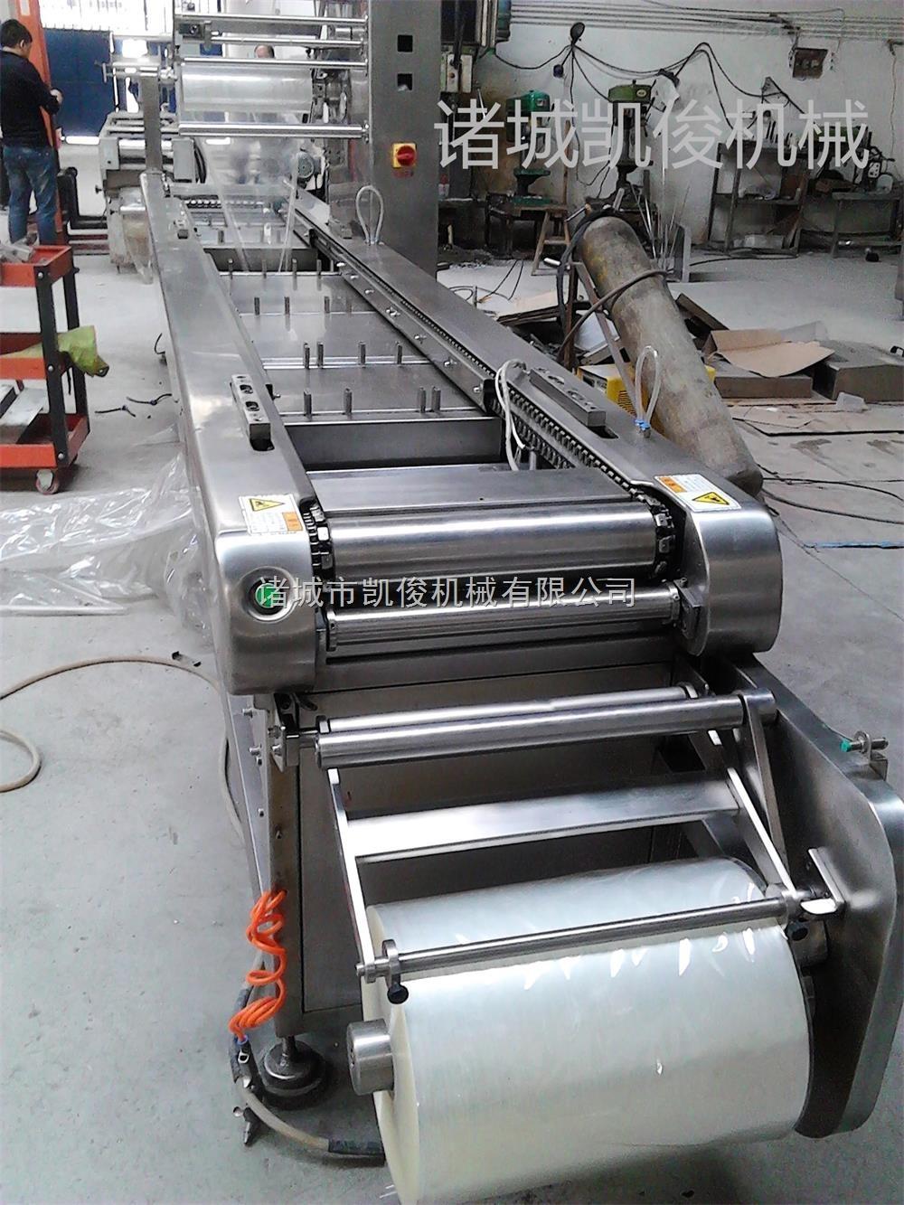 萝卜干拉伸膜真空包装机 连续滚动式真空包装机